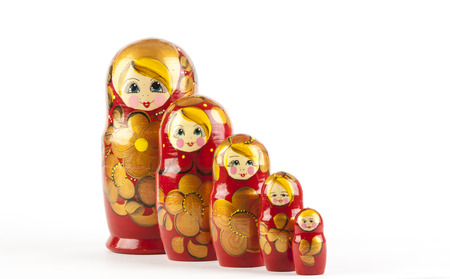 Babushkas or Matrhka dolls on a wooden background