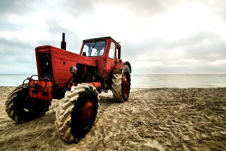 old tractor on beach. Editorial
