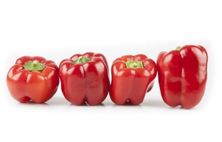 Red peppers on white Stock Photo