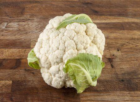 fresh cauliflower on wooden background