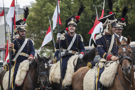 Parade of Polish soldiers in historical uniforms. Day of Polish Army
