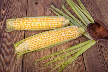 Corn on the cob on a wooden background. View from another angle in the portfolio.
