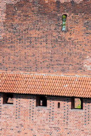 attic: Old bricks and roof tiles texture Stock Photo