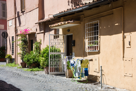 deteriorate: Laundry in front of an entrance to a residential building, Trastevere