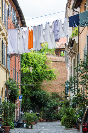 Laundry hanging above the street, Trastevere, Rome