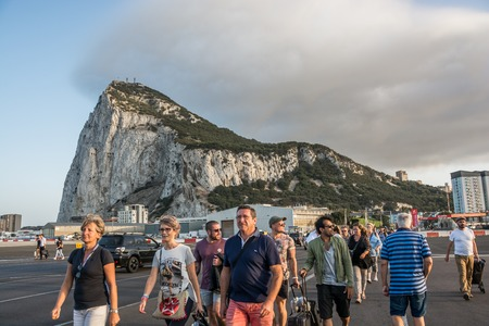 GIBRALTAR - September 13, 2017 - People walking through airport runway Editorial