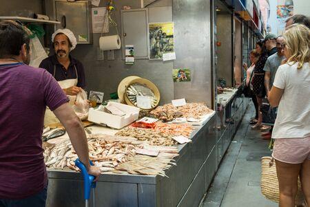 MALAGA, SPAIN - September 16, 2017 - Man selling sea food Archivio Fotografico - 129998387