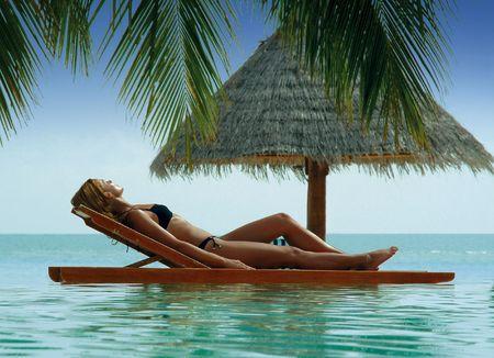 recline: sunbathing woman