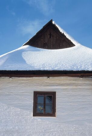 wooden cottage covered by snow photo