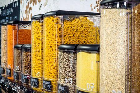 Bulk dry food dispensers at zero waste shop, defocused