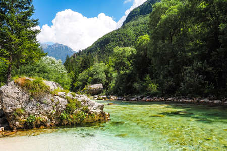 The shore of the Soča river in Slovenia in the summer