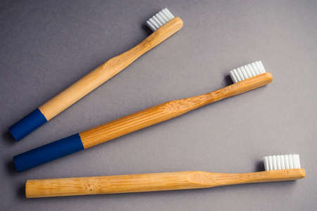 Three bamboo wood toothbrushes