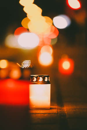 Candles on the sidewalk in memory of victims of a tragic accident, mourning, memory. Selective focus Stock Photo