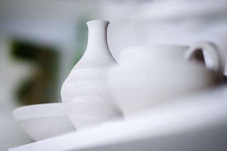 Minimalistic and futuristic high-end ceramics pottery artists workshop. Selective focus Standard-Bild - 163926809