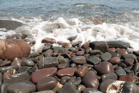 Kieselsteine ??am Strand von Welle Washed