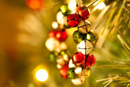 evocative: Jingle Bell Wreath Christmas Tree Decoration side view Stock Photo