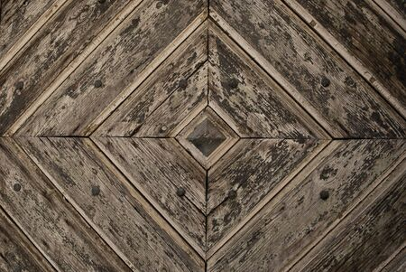 Detail of an old wooden patterned door as a background image Standard-Bild