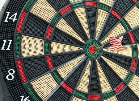 Shot of dart arrow in bulls-eye.