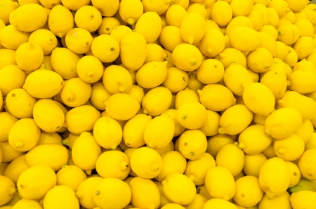 Colorful Display Of Lemons In A Market photo