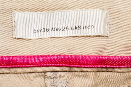 medium size: Macro Photo Of A Clothing Label Showing Medium Size (European, Mexican, United Kingdom and Italy Equivalents)