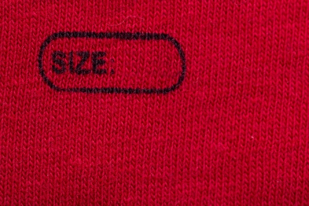 Macro Photo Of A Clothing Label Showing The Text Size Stock Photo - 17992313