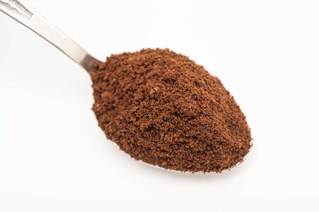 cocoa powder: Spoon With Coffee On A White Background