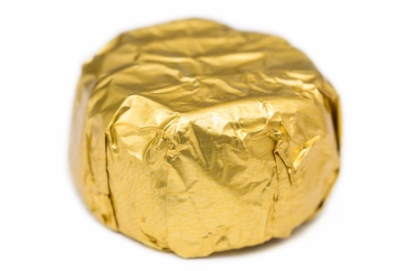 Candy In Golden Foil On A White Background Stock Photo - 17992191