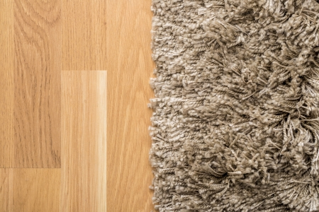 carpet and flooring: Fluffy Carpet On Laminate Floor Stock Photo