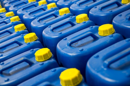 Many Blue Fuel Tanks With Yellow Caps Stock Photo