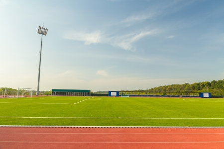 track and field athlete: Empty Stadium Arena With Football Field And Racing Tracks Editorial