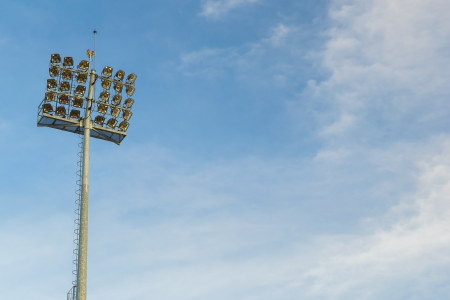 Stadium Lights On A Blue Sky photo
