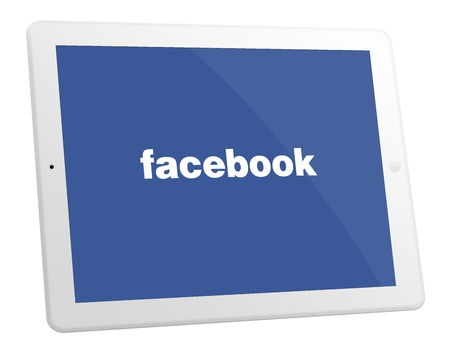 displayed: White Apple iPad 4 With Facebook Displayed On The Screen Editorial