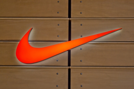 nike: The Famous Nike Logo On A Wooden Wall