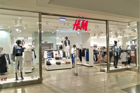 hm: H&M Store. Hennes & Mauritz AB is a Swedish retail-clothing company, known for its fast-fashion clothing offerings for women, men, teenagers and children. It is ranked the second largest global clothing retailer.