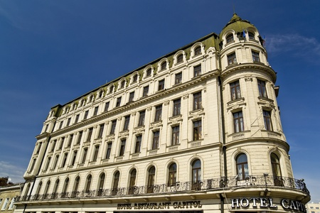 Capitol Hotel is placed in one of the most busy and populated area of Bucharest, Romania. The 5 level building was raised up in 1901, and in the past time was sheltered a hotel and famous cafe, the favorite meeting place for many important people. Stock Photo - 18322252