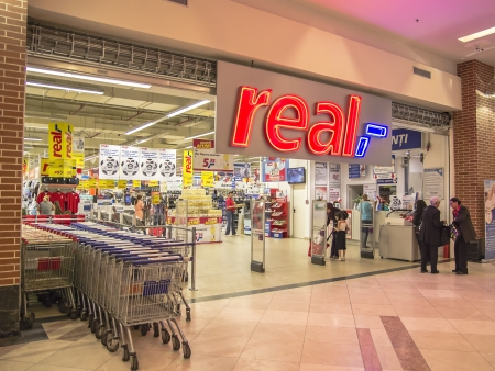ag: Real Supermarket Entrance. Real is a European hypermarket, member of the German trade and retail giant Metro AG. Editorial