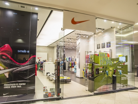 Nike Store Entrance. Nike is a major publicly traded clothing, footwear, sportswear, and equipment supplier based in the United States. The company is headquartered near Beaverton, Oregon, in the Portland metropolitan area.