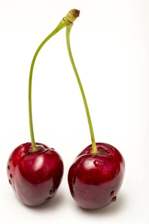 Macro Photo Of Two Cherries With Water Drops On A White Background Stock Photo - 18366955