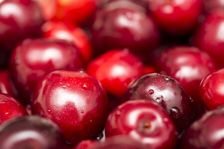Macro Photo Of Many Fresh Wet Cherries Displayed In A Fruit Market Stock Photo - 18366963