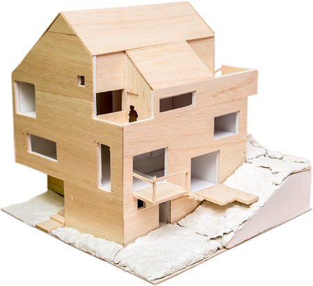Perspective View Of A House Model  Under Construction  Made From Wood Isolated On White Stock Photo