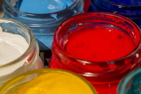 Closeup Photo Of Acrylic Paint Bottles  Red, Cyan, Yellow And White photo