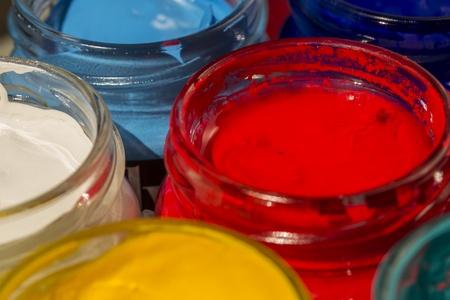 liquids: Closeup Photo Of Acrylic Paint Bottles  Red, Cyan, Yellow And White Stock Photo
