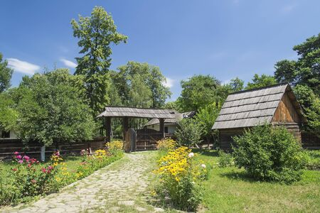 Old Traditional Romanian Rural Household On A Beautiful Summer Day  This is a house specific to Suceava county from the 19th century  Stock Photo - 18368054