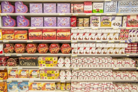 merchandiser: Supermarket Shelves Full With Different Candy Boxes Editorial