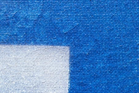 Painted Canvas  One Quarter Painted With White And Three Quarters Painted In Blue photo