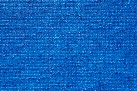 Macro Photo Of A Canvas Painted With Blue Acrylic Paint photo