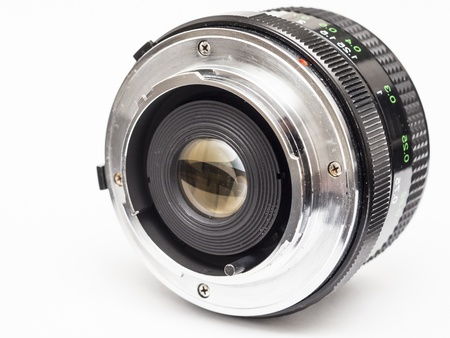 attaching: Old Prime Lens With Classic M42 Mount On A White Background  The M42 lens mount is a screw thread mounting standard for attaching lenses to 35 mm cameras, primarily single-lens reflex models