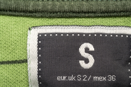 equivalents: Macro Photo Of A Clothing Label Showing Size S  Small  And Equivalents In Uk and Mexican Sizes