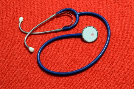 Medical Stethoscope On A Red Carpet Texture Stock Photo - 18441542
