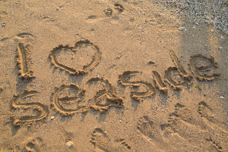 I Love Seaside Written On Sand photo